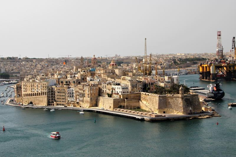 Valletta, Malta, July 2014. Old fortress and modern shipyard. stock image