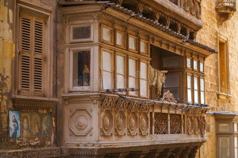 VALLETTA, MALTA - NOVEMBER 12, 2018 - Typical Maltese covered balconies royalty free stock image