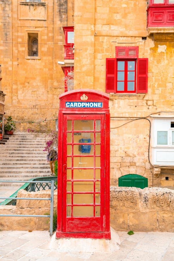 Valletta, Malta - Rode uitstekende Britse telefooncel stock afbeeldingen