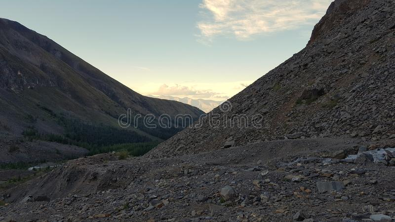 Valley of the Aktru in the Altai. Summer, sunset, sky, clouds, mountains, nature, stone royalty free stock photo