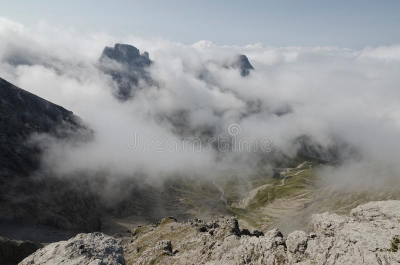 Valley covered by clouds in the Lienz Dolomites, Austria. Landscape picture of mountain valley covered by clouds in the Lienz Dolomites, Austria royalty free stock photography