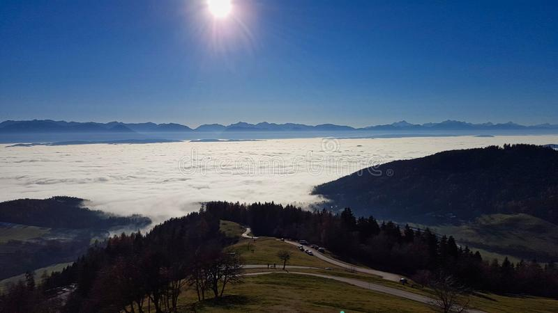 a valley is covered with fog stock photography