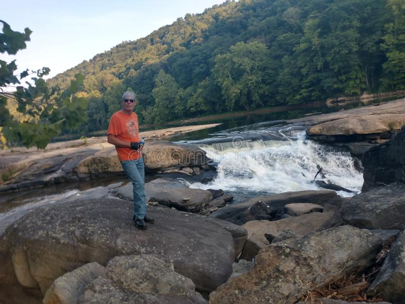 Valley Falls State Park. Beautiful scenery in Fairmont, WV at Valley Falls State Park. Many rocks to walk around the water. Tygart River is a local and tourist royalty free stock photo