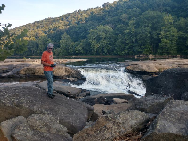 Valley Falls State Park. Beautiful scenery in Fairmont, WV at Valley Falls State Park. Many rocks to walk around the water. Tygart River is a local and tourist royalty free stock photography