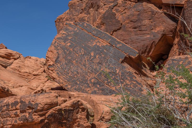 Anchient Petroglyphs at the Valley of Fire State Park, Nevada. Valley of Fire State Park is a public recreation and nature preservation area covering nearly 46 stock image