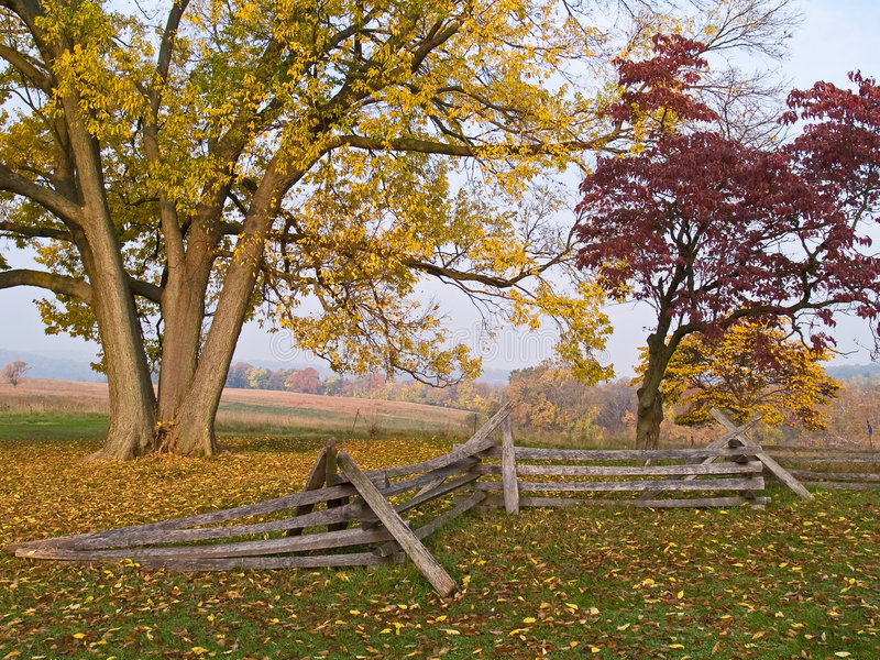 Valley Forge Morn. An old colonial fence and beautiful Fall foliage is an example of the scenery in Valley Forge National Park in Pennsylvania royalty free stock photos