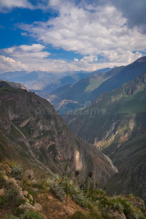 Valley on the Inca trail. On the Inca trail, a beautiful and deep valley opens up between the green and lush mountains on a partially cloudy day in Peru royalty free stock photos