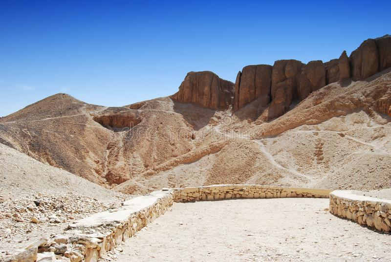The valley of the kings in the desert at Thebes near Luxor, Egypt. The valley of the kings in the desert at Thebes near Luxor royalty free stock image