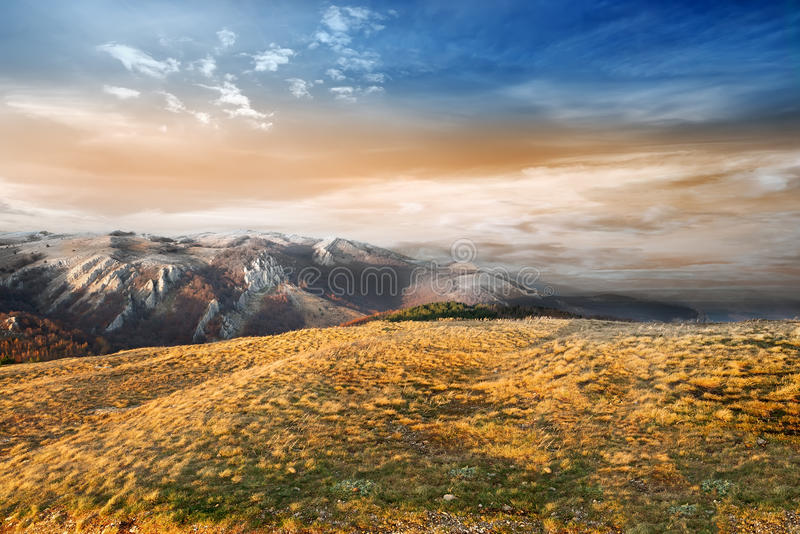 Valley in the mountains. Late autumn in the mountains at sunset royalty free stock photo