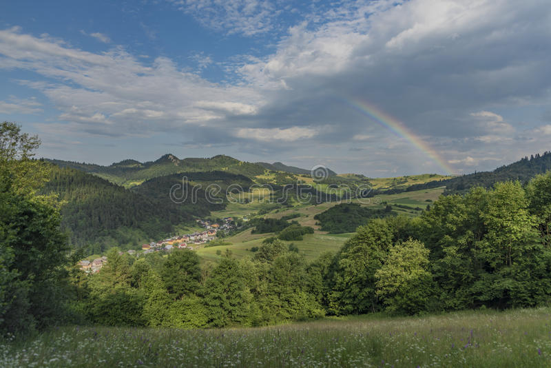 Valley near Lesnica village after storm with rainbow. In national park Pieniny stock images