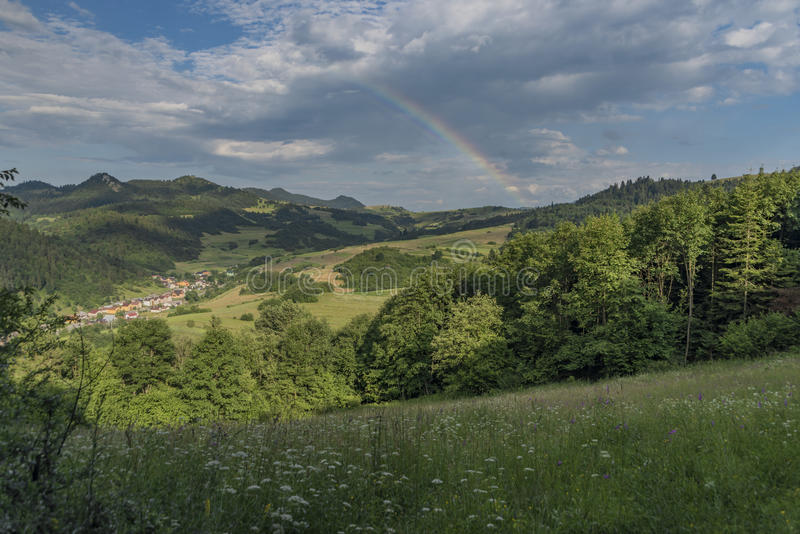 Valley near Lesnica village after storm with rainbow. In national park Pieniny stock photo