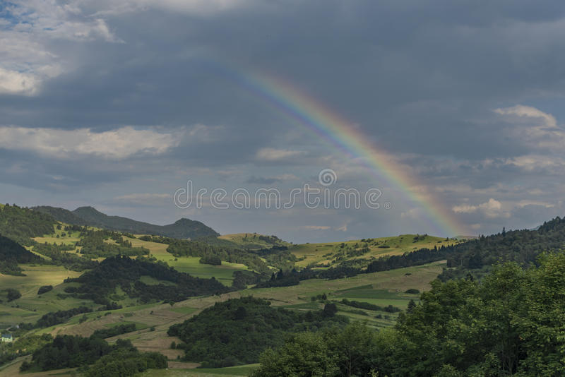 Valley near Lesnica village after storm with rainbow. In national park Pieniny royalty free stock photos