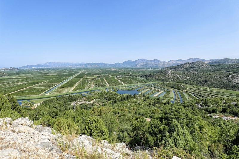Valley of Neretva river delta. With fields and gardens stock photos