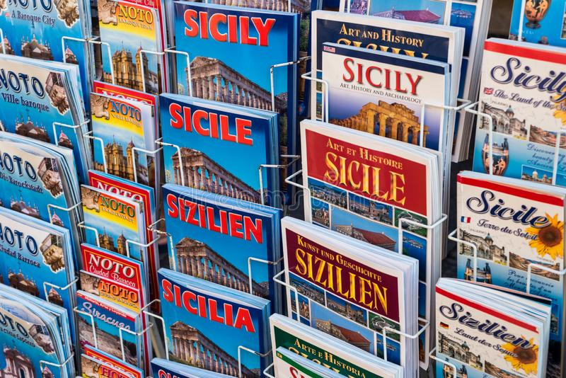 Valley of Noto Sicily. Tourist guides of Noto in different languages stock images