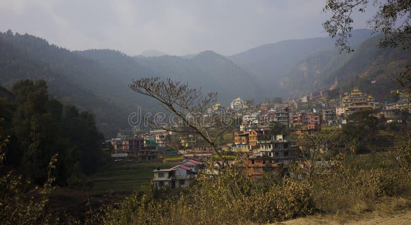 Valley outside of Kathmandu, Nepal with colourful houses. A green valley outside Kathmandu, Nepal in winter with colourful houses surrounding it royalty free stock photography