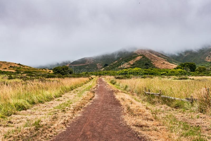 Valley road in Marin Headlands area on a foggy summer day, Golden Gate National Recreation Area, Marin County, California stock photo