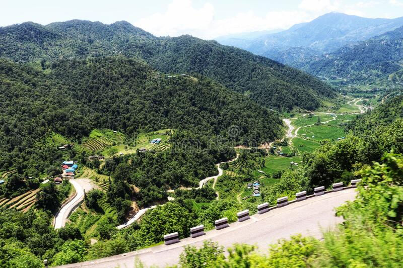 Valley roads greenery forest curves of road  in nepal sindhuli highway. Beautiful view travelling forest royalty free stock images