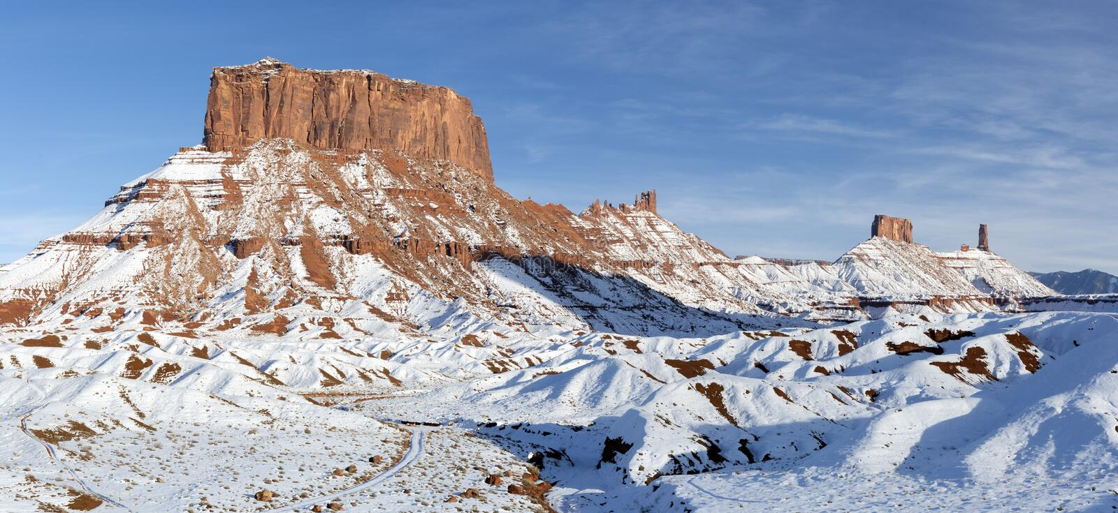 Valley of Snow. A Panoramic image of the mesas and towers in Castle Valley on a snowy day near Moab, Utah stock images