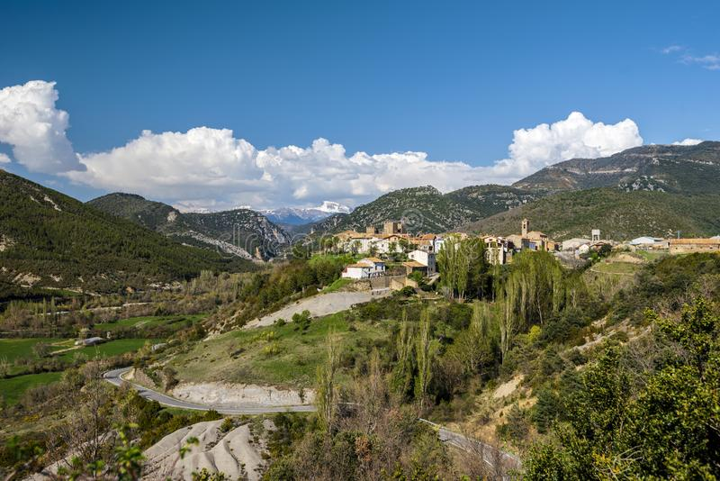Valley of Veral river in Spanish Pyrenees in Aragon region.  Binies village with the castle and San Salvador church is at right. And the beginning of the canyon stock photography