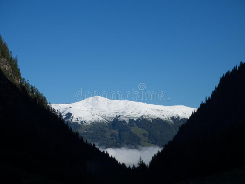 Valley view to snowcapped mountain. On a sunny day stock photos