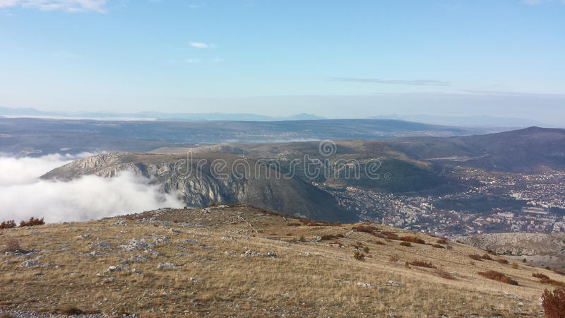 Valleys of Mostar. Valleys of central Bosnia close to Mostar city with fog and clouds royalty free stock photography