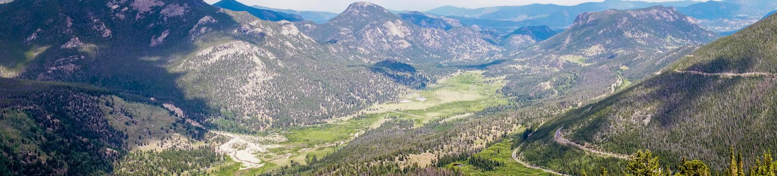 Valleys and mountain peaks of the Rocky Mountains. Travel to the Rocky Mountain National Park. Colorado, United States. Summer high mountain valley. Rocky stock photo