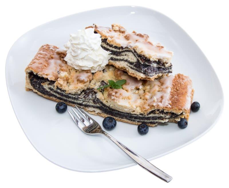 Vallmo-Kärna ur tårtan på vit arkivbilder