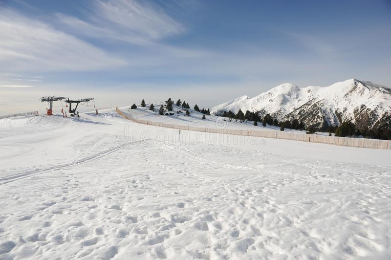 Vallnord ski lift La Tossa, Europe, the Principality of Andorra, the eastern Pyrenees, the sector of skiing Pal. Vallnord ski lift La Tossa against the royalty free stock photo