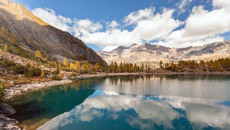 Valmalenco IT - Lagazzuolo Lake. In autumn landscape royalty free stock photo