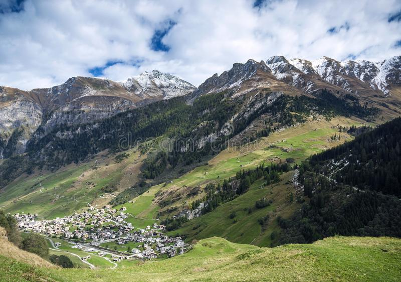 Vals village alpine valley landscape in central alps switzerland. Vals village alpine valley landscape and homes in central alps switzerland stock images