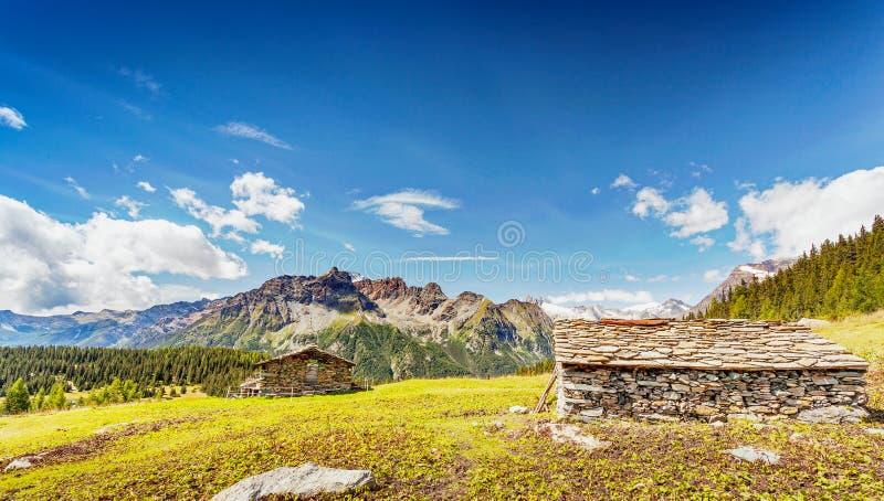 Valtellina - Valmalenco IT - Typical stone huts. In the  Palù Lake area royalty free stock photo