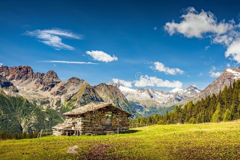 Valtellina - Valmalenco IT - Typical stone huts. In the  Palù Lake area stock photos