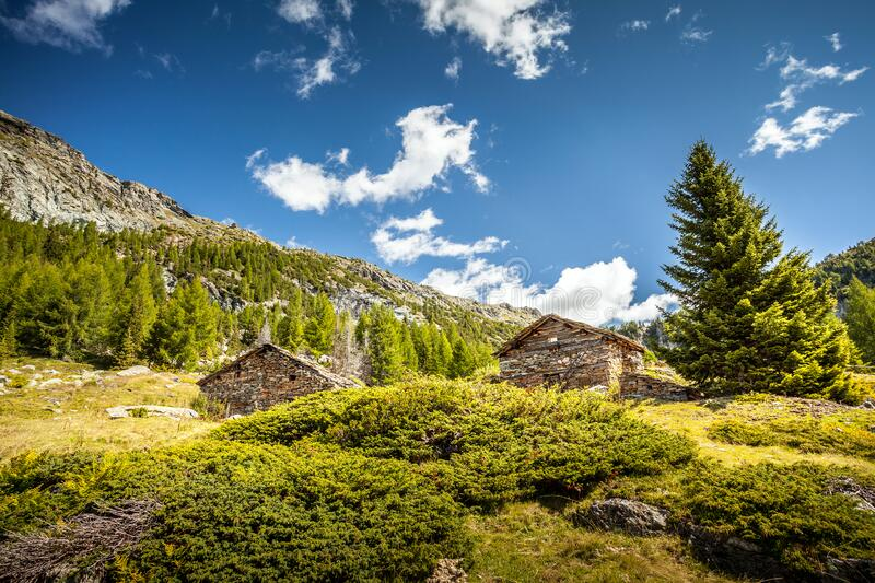 Valtellina - Valmalenco IT - Typical stone huts. In the  Palù Lake area stock images