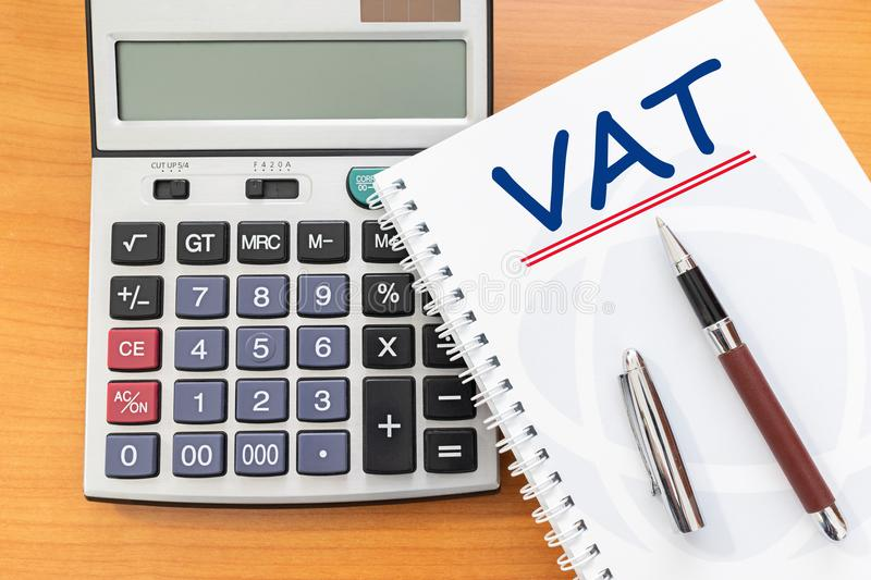 Value Added Tax VAT Finance Taxation Accounting Concept, VAT word handwritten on notebook stock photography