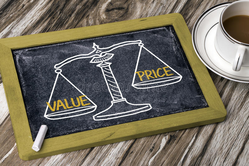 Value price concept. On balance scale royalty free stock photos
