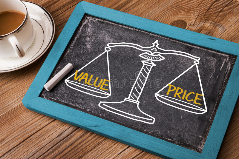 Value price concept. On balance scale royalty free stock photography