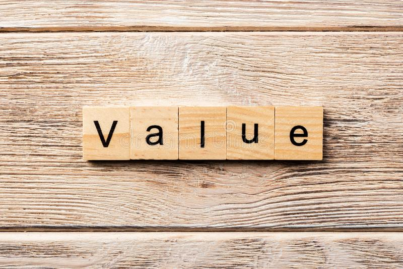 Value word written on wood block. value text on table, concept royalty free stock photography