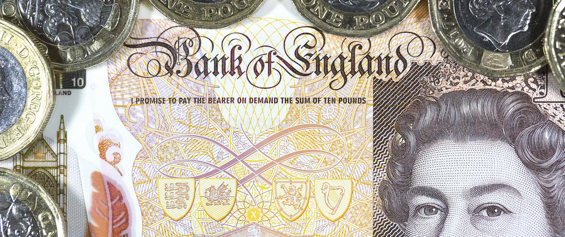 Valuta britannica - nuovo polimero una nota da dieci libbre fotografie stock