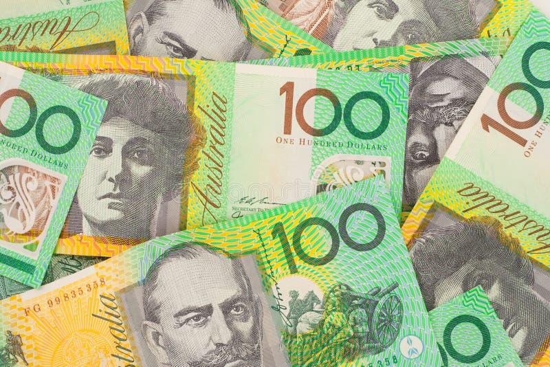 valuta för 100 australiensisk bakgrundssedlar arkivbild