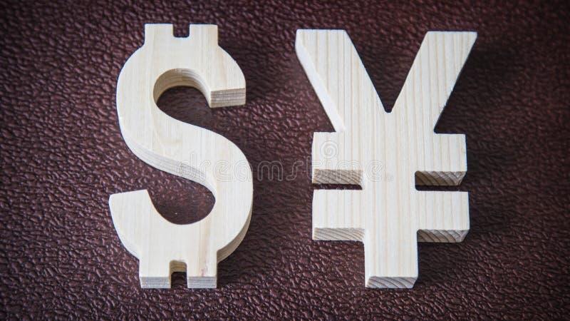 Valutazione di scambio Dollaro, Yen su fondo di cuoio fotografie stock