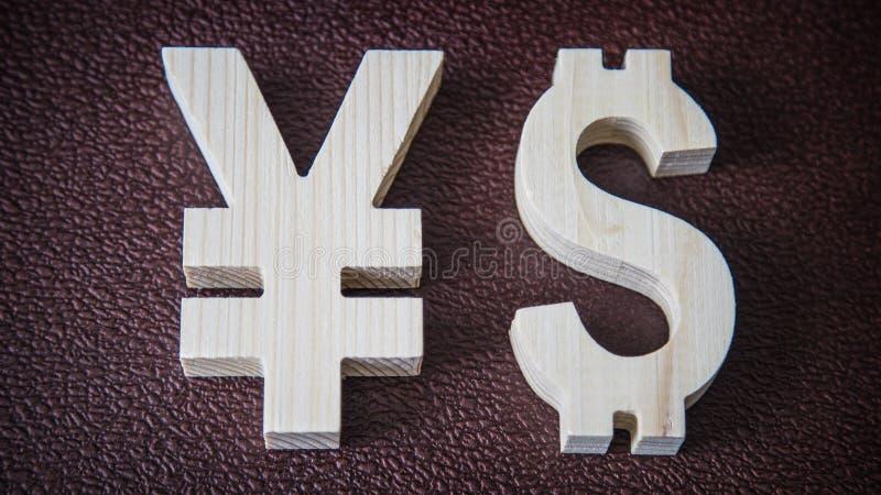 Valutazione di scambio Yen, dollaro su fondo di cuoio fotografia stock