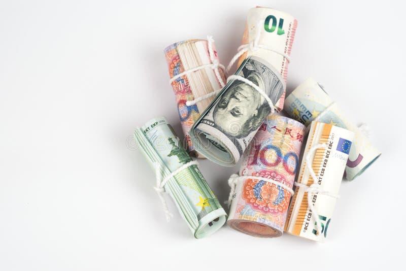 Valutor och begrepp för handel för pengarutbyte Rullarna av dif royaltyfri fotografi