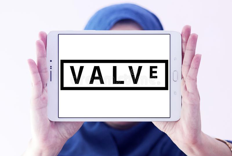 Valve Corporation logo. Logo of Valve Corporation on samsung tablet holded by arab muslim woman. Valve Corporation is an American video game developer and stock photos