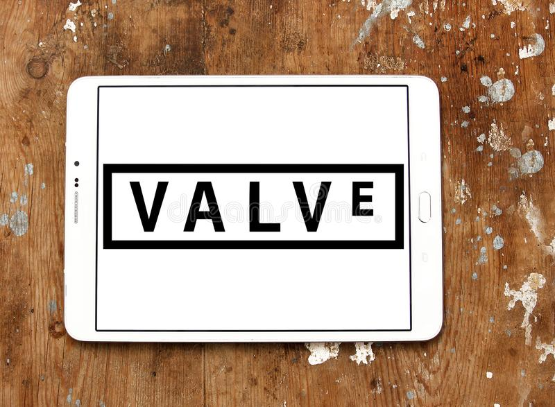 Valve Corporation logo. Logo of Valve Corporation on samsung tablet on wooden background. Valve Corporation is an American video game developer and digital stock photo