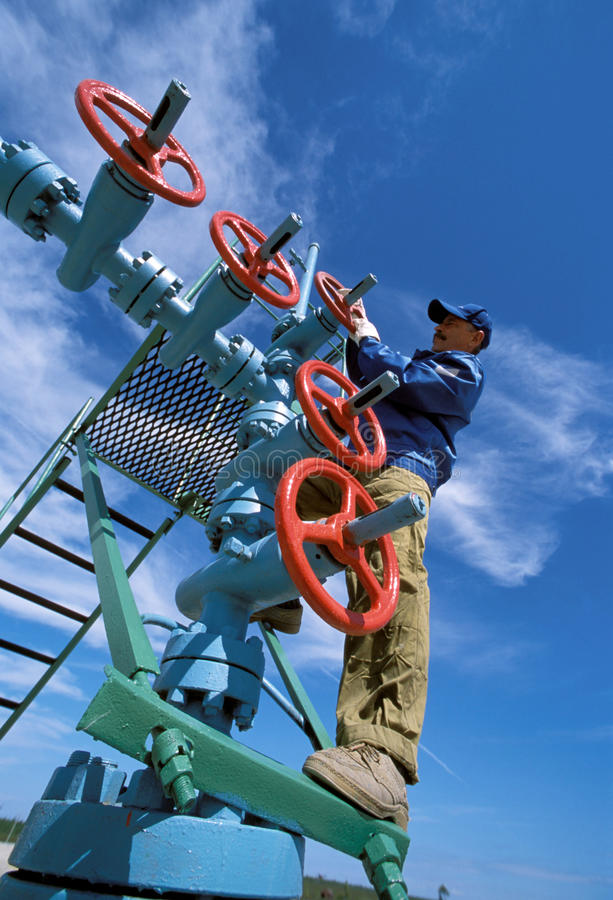 The valve on the gas field stock image