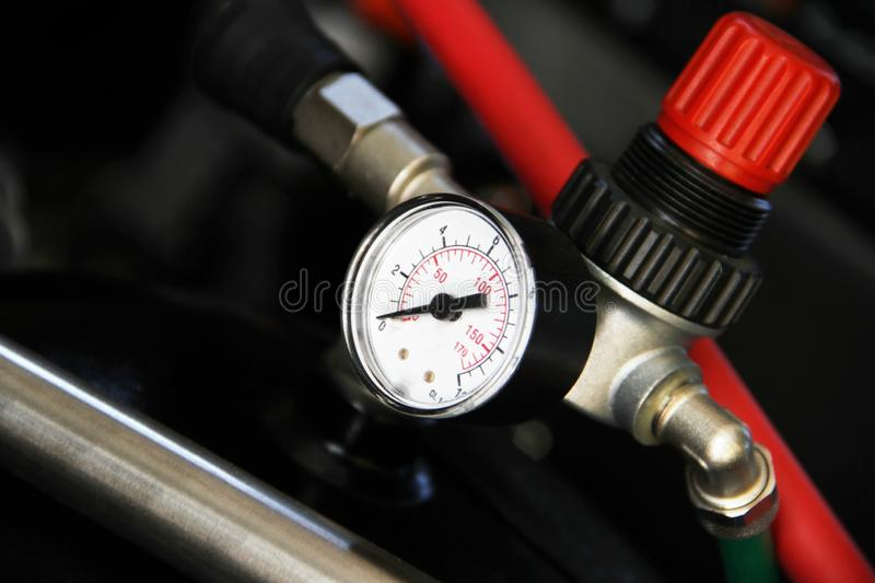 The valve and pressure indicator part of machine royalty free stock image