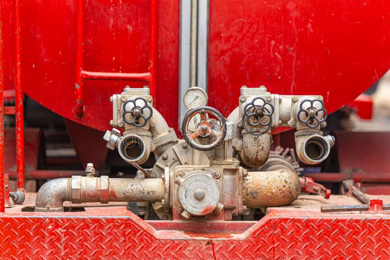 Valve water pump jet hose with water tank guage behide of fire truck. Valve water pump jet hose with water tank gauge be hide of fire truck royalty free stock photo