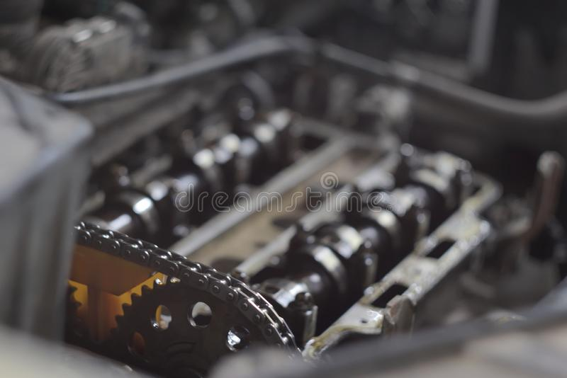 Disassembled car engine in autoservice stock images