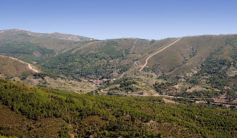 Valverde del Fresno. Mountains of Valverde del Fresno located in the Spanish province of Caceres, you can see the village surrounded by moutains and trees, is a stock photography