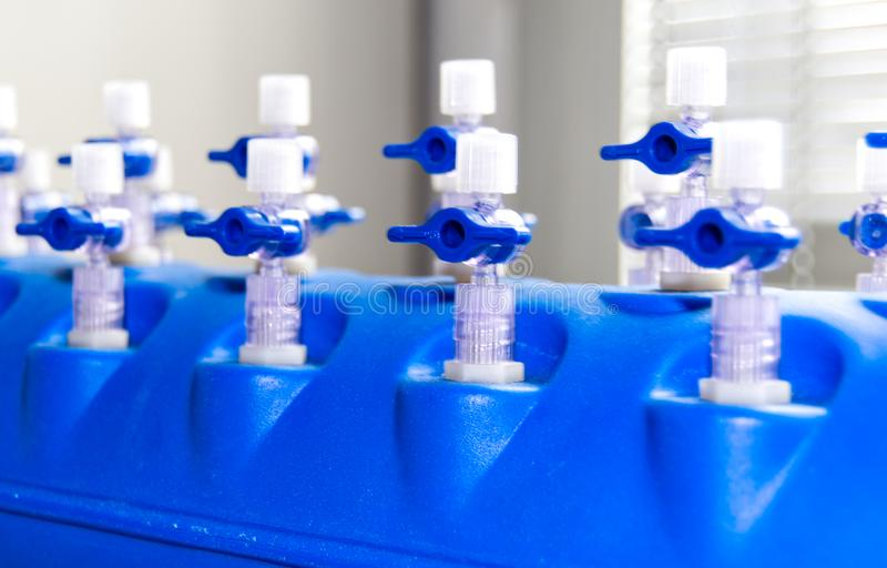 Valves for liquid system station. Labware, laboratory royalty free stock images